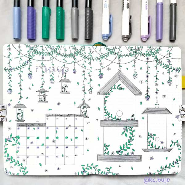 Gorgeous birdhouse themed May calendar spread with pretty doodles